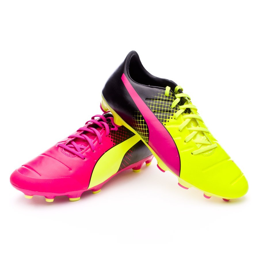 9d4ca5ba836f Puma evoPower 2.3 AG Tricks Football Boots. Pink glo-Safety yellow-Black ...