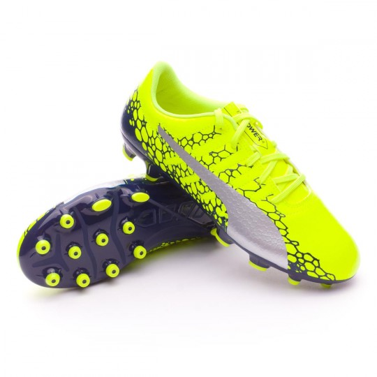 Boot Puma Kids evoPOWER Vigor 4 Graphic AG Safety yellow-Silver-Blue depths  - Soloporteros es ahora Fútbol Emotion 22fe86caea8d8