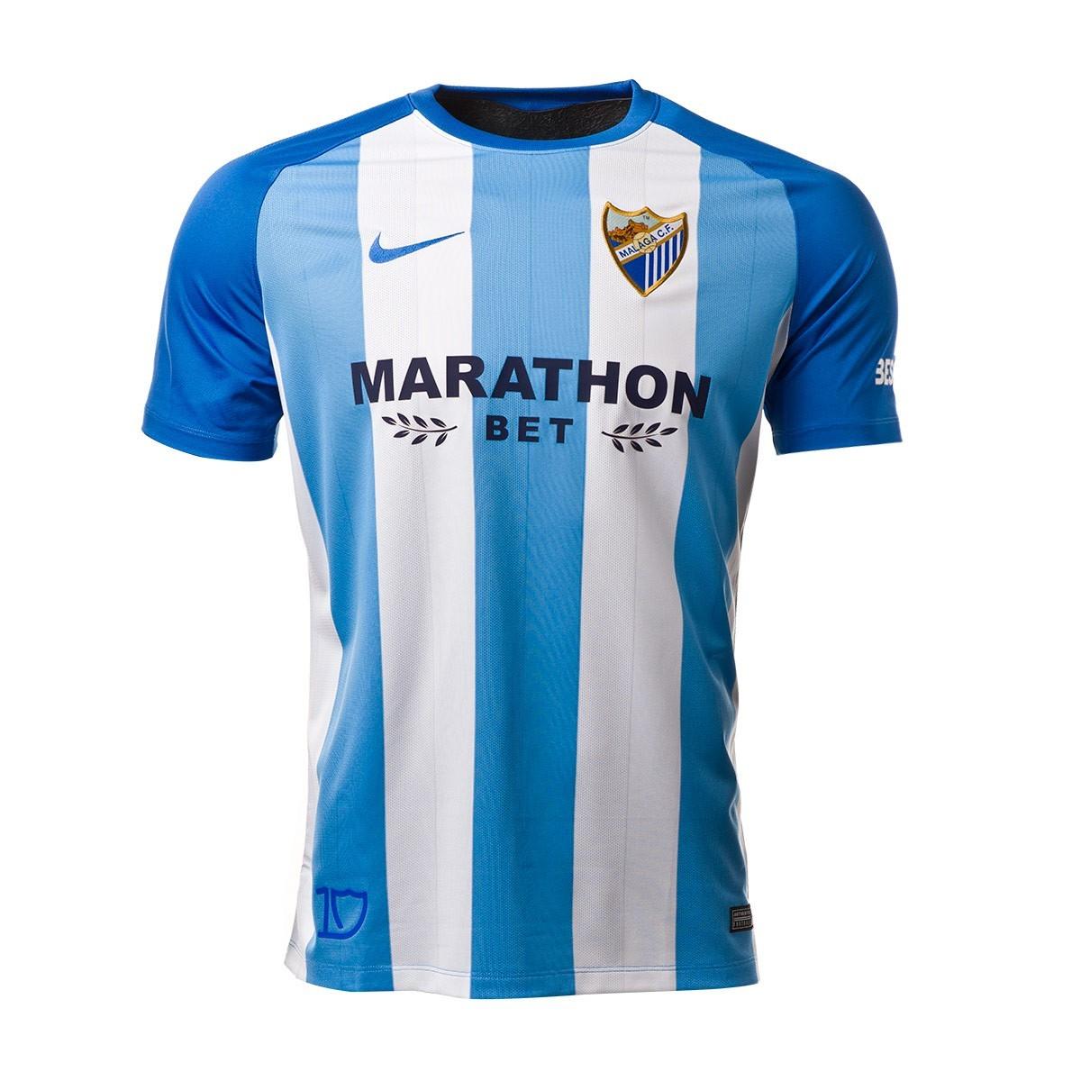 d463886a92 Camiseta Nike Málaga CF Primera Equipación 2017-2018 Niño Blanco-Azul -  Soloporteros es ahora Fútbol Emotion
