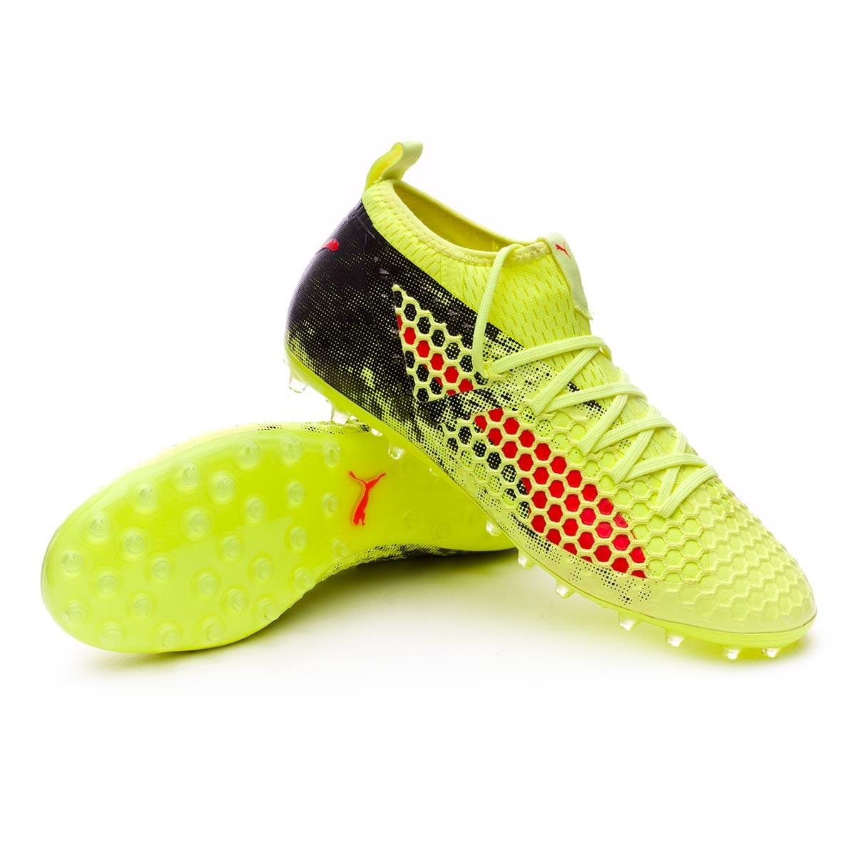 Puma Future 18.2 Netfit MG Boot. Fizzy Yellow-Red Blast-Puma Black ... 68ff7158d