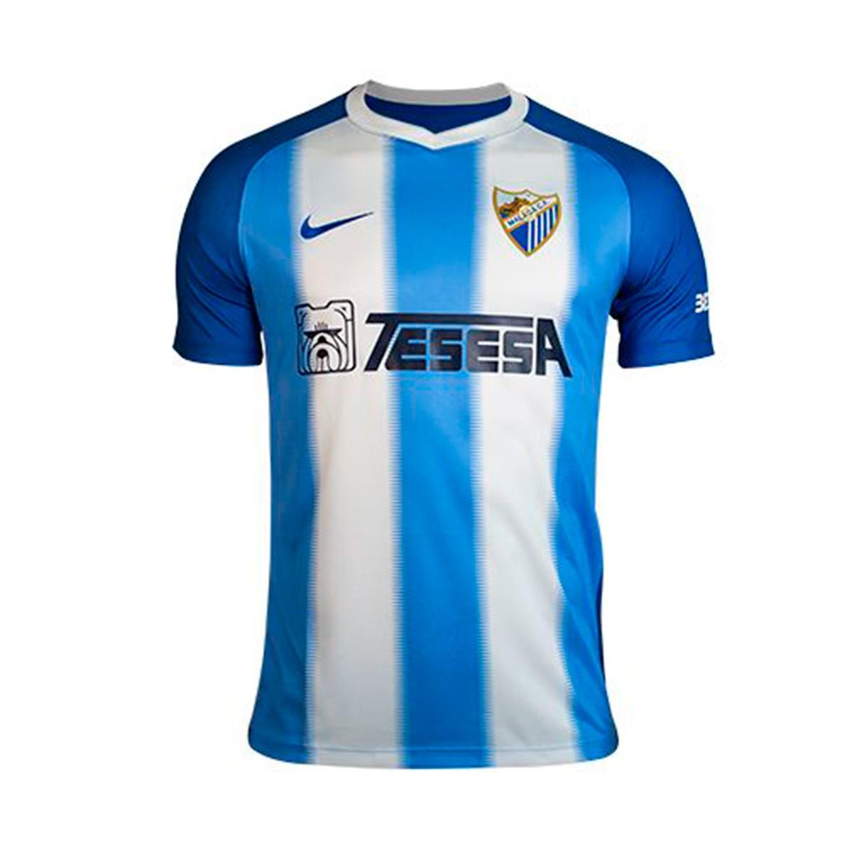 86a4ade72954b Camiseta Nike Málaga CF Primera Equipación 2018-2019 Niño Blanco-Azul -  Tienda de fútbol Fútbol Emotion