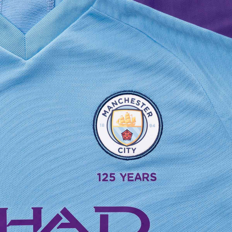 camiseta-puma-manchester-city-fc-primera-equipacion-2019-2020-nino-team-light-blue-tillandsia-purple-2.jpg