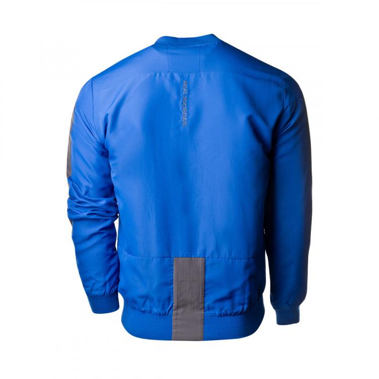 chaqueta-macron-real-sociedad-paseo-2019-2020-blue-1.jpg
