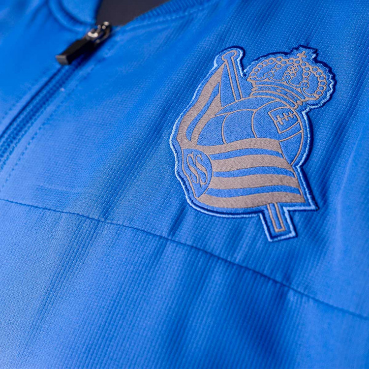 chaqueta-macron-real-sociedad-paseo-2019-2020-blue-2.jpg