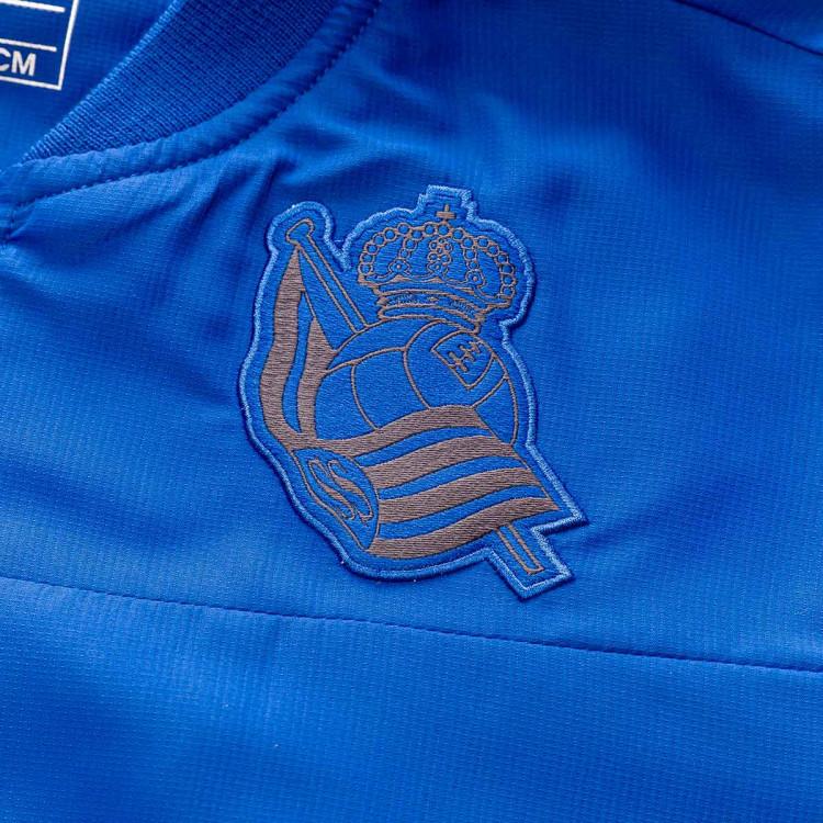 chaqueta-macron-real-sociedad-paseo-2019-2020-nino-blue-2.jpg