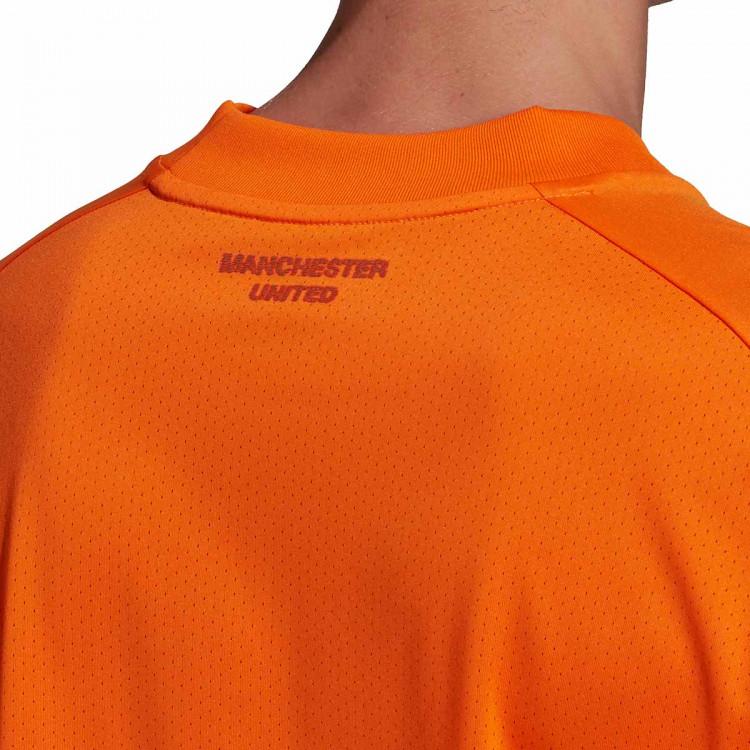 camiseta-adidas-manchester-united-fc-training-2020-2021-bahia-orange-3.jpg