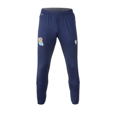 pantalon-largo-macron-real-sociedad-training-2020-2021-nino-anthracite-royal-0.jpg