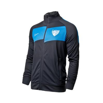 chaqueta-nike-malaga-cf-player-2020-2021-blue-grey-0.jpg