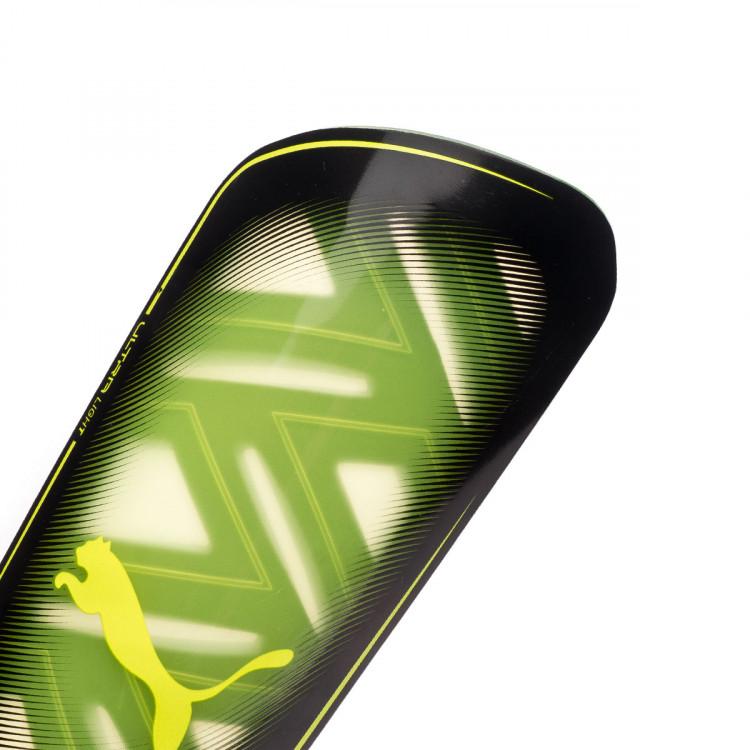 espinillera-puma-ultra-light-sleeve-amarillo-1.jpg