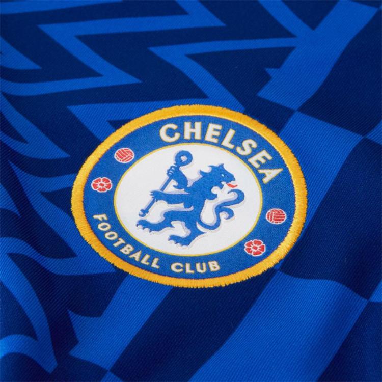 camiseta-nike-chelsea-fc-primera-equipacion-stadium-2021-2022-nino-lyon-blue-opti-yellowfull-sponsor-2.jpg