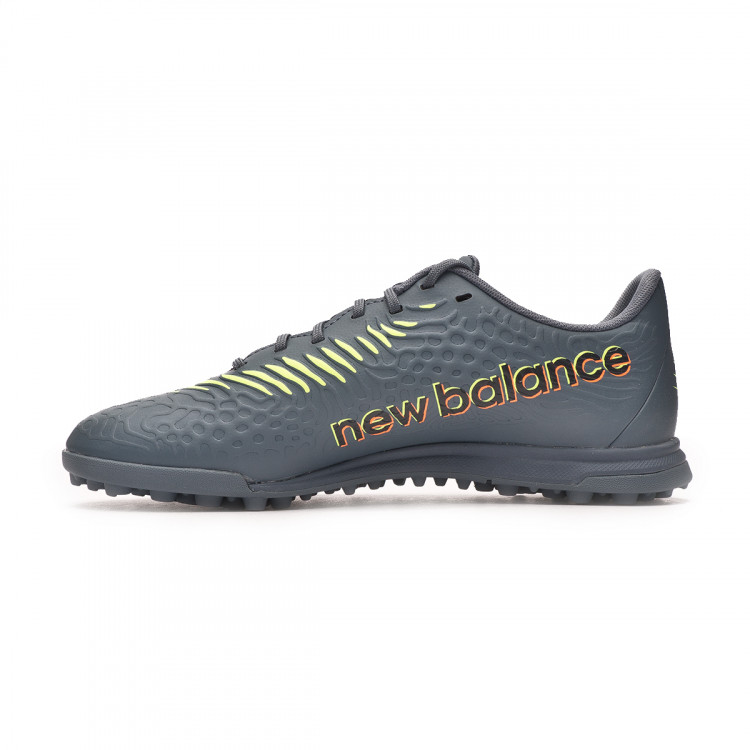 bota-new-balance-tekela-v3-magique-turf-nino-azul-oscuro-2.jpg