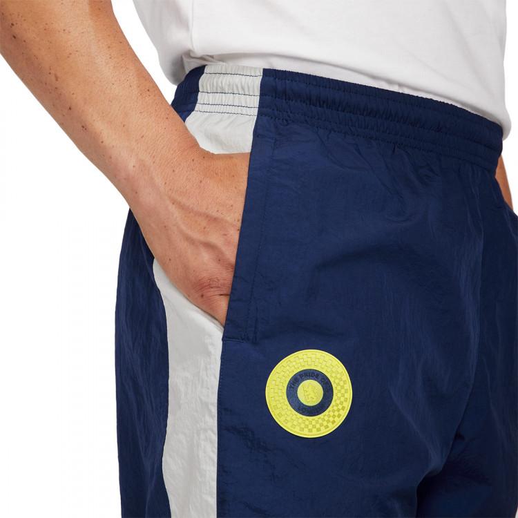 pantalon-largo-nike-chelsea-fc-nsw-wr-2021-2022-azul-3.jpg
