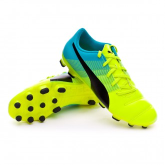 Chuteira  Puma jr evoPOWER 4.3 AG Safety yellow-Black-Atomic blue
